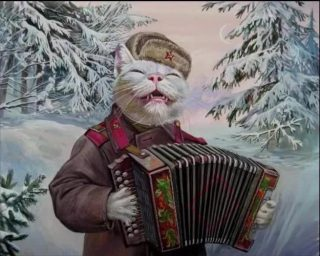 Cat playing accordion with snowy trees in the background.