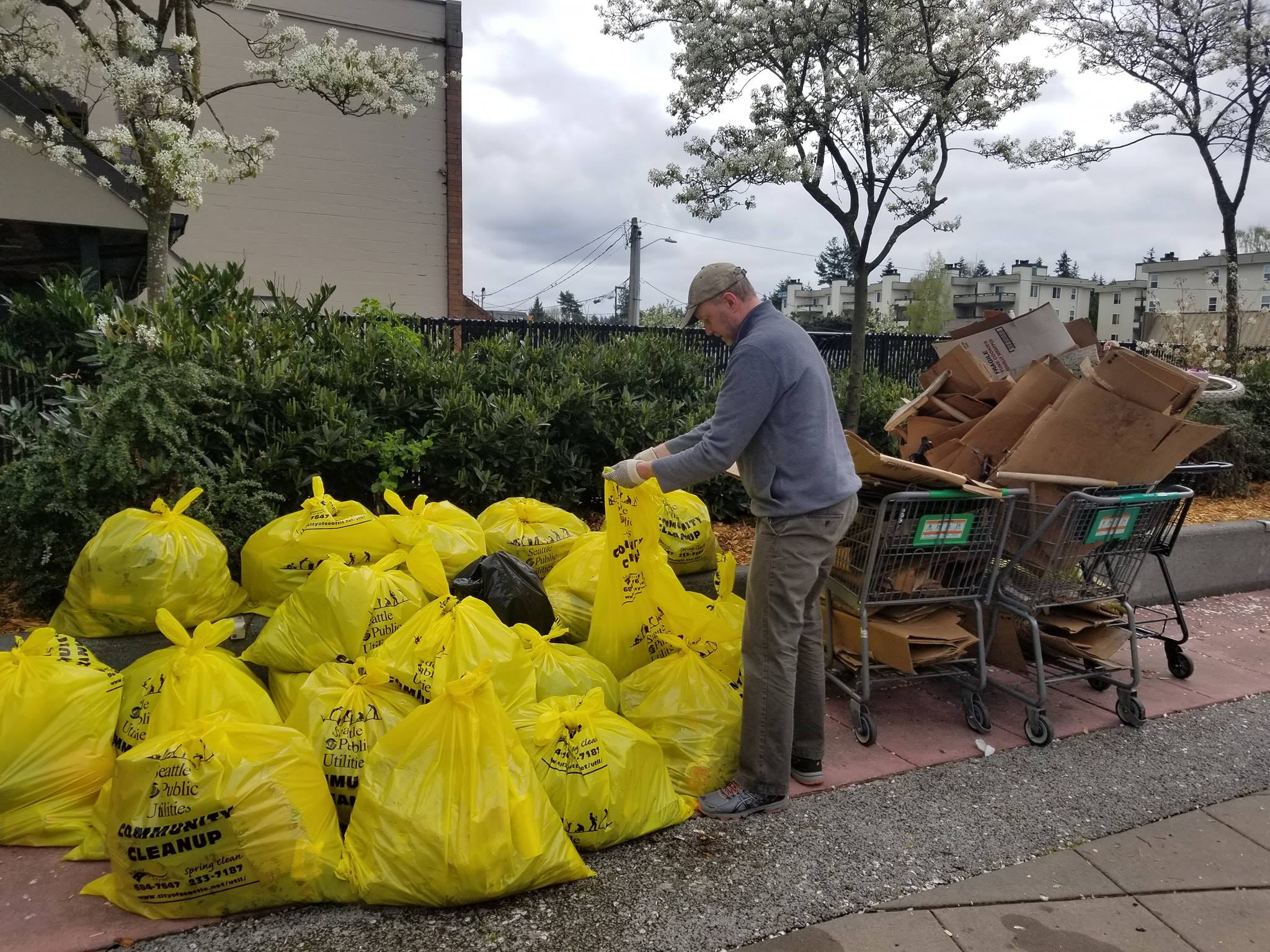 Chris with many bags of trash from Lake City Clean Up